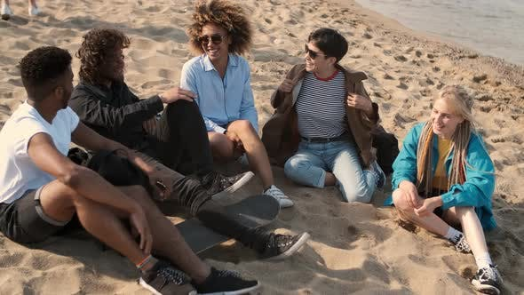 Thumbnail for Lounging Happy Friends on Beach