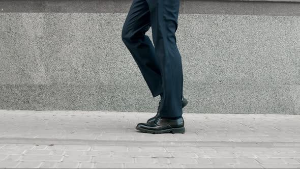 Thumbnail for Business Man Legs Walking in Black Shoes. Closeup Black Shoes Walking Outdoor