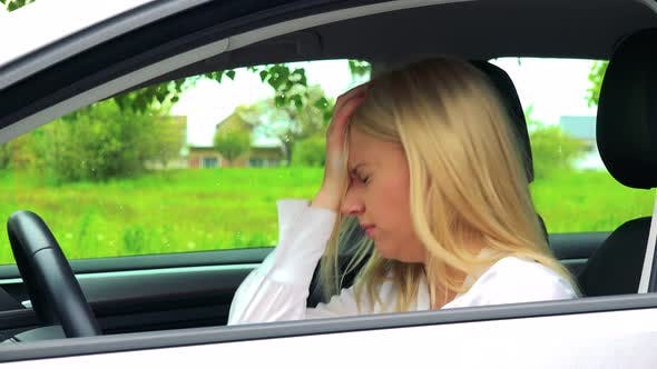 Thumbnail for Young Attractive Blond Woman Sits in the Car and Has Depression