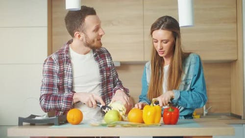 A Attractive Couple Is Cooking on Kitchen