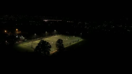 Football Practice on a Floodlit Astroturf Pitch