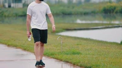 a Man Walking Down the Path