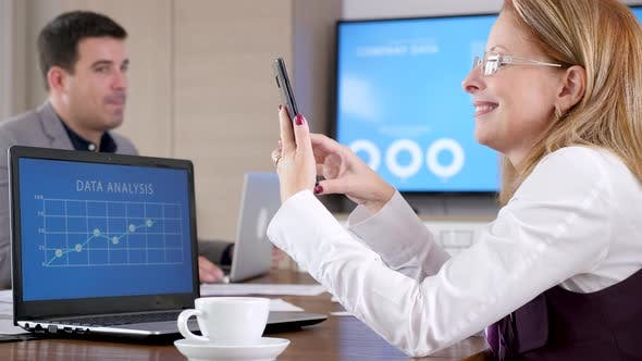 Thumbnail for Businesswoman in Conference Room Looking at Phone