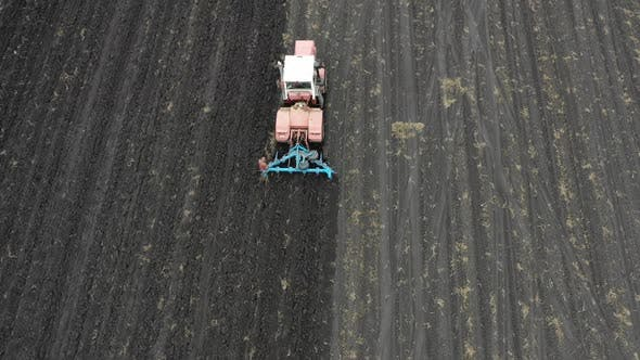 Thumbnail for Aerial View: Tractor with a Plow Cultivating the Field. Agricultural Concept