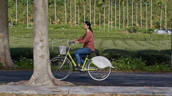 Thumbnail for Woman ride a bike