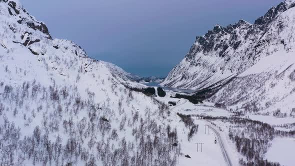 Mountains, Road and Frozen Lake in Winter. Valley. Troms, Norway. Aerial View