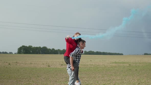 Thumbnail for Man Piggybacking Woman with Smoke Bomb in Countryside