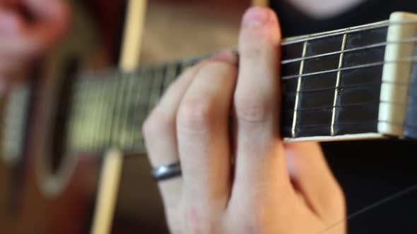 Thumbnail for Musician Playing An Acoustic Guitar