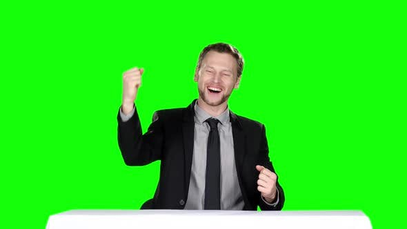Cover Image for Happy Businessman Sitting at the Table. Green Screen