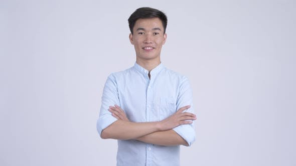Young Happy Asian Businessman Clapping Hands and Getting Good News