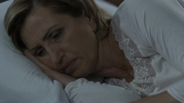 Cover Image for Woman suffering from insomnia because of stress, female health, menopause