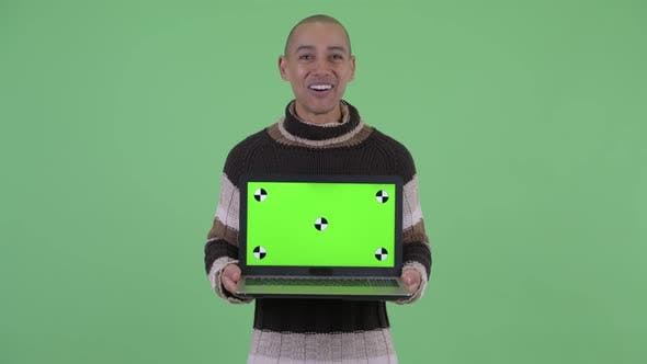 Thumbnail for Happy Bald Multi Ethnic Man Showing Laptop and Looking Surprised