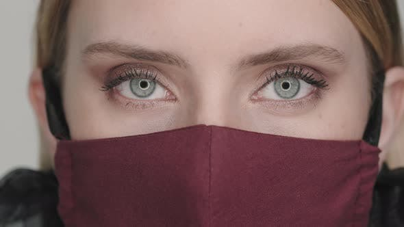 Extreme Close Up of Woman in Face Mask