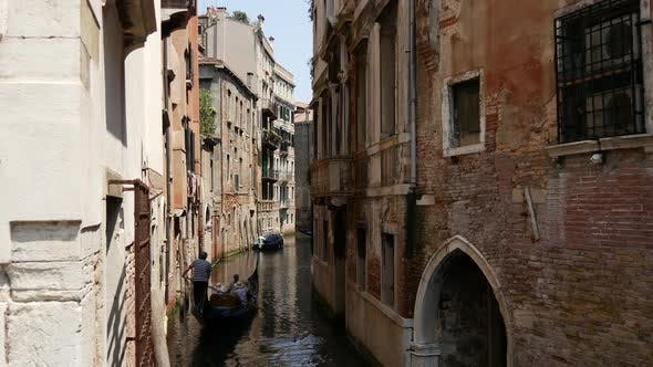 Cover Image for Gondolas in a canal in Venice