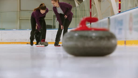 Thumbnail for Curling Training - Leading Granite Stone on the Ice - Two Women Rubbing the Ice Before the Stone
