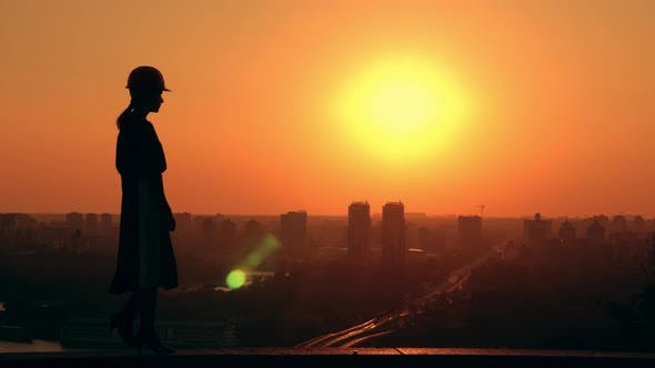 Thumbnail for Woman Architect Outdoors Cityscape at Sunrise
