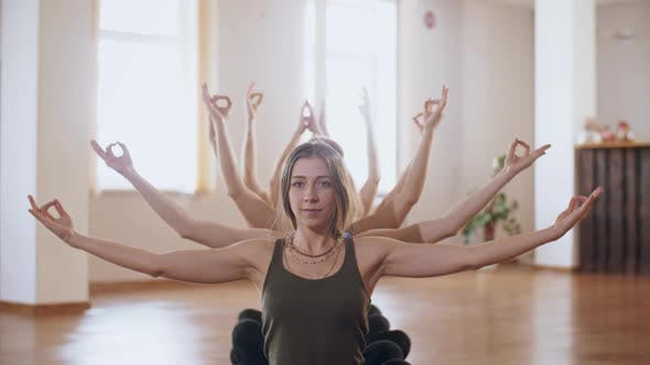 Thumbnail for Woman Shows a Multi-armed Form