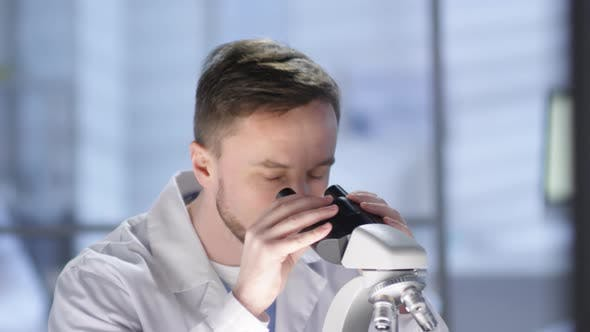 Thumbnail for Happy Caucasian Lab Technician Working with Microscope