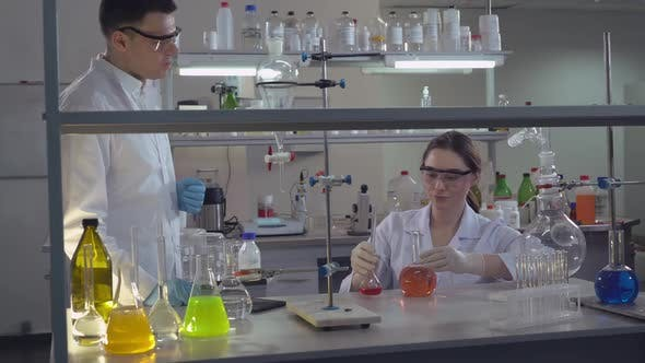 Thumbnail for Chemist Engineer Holding Flasks Adding Liquid To Test-tubes With