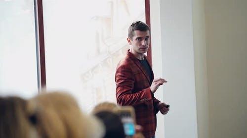 Man Speaker Teaching Public in the Hall