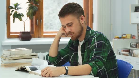 Tired Guy Falls Asleep While Studying