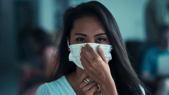 Thumbnail for Young Asian Woman Wearing a Medicine Mask