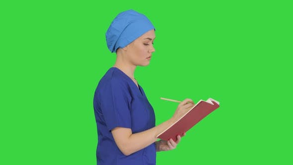 Female Professional Doctor Hand Making Notes Medical Journal While Walking Green Screen Chroma Key