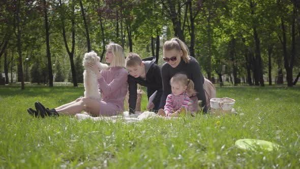Thumbnail for Portrait Nice Family Outdoor Recreation. Two Beautiful Young Mothers and Their Children at a Picnic