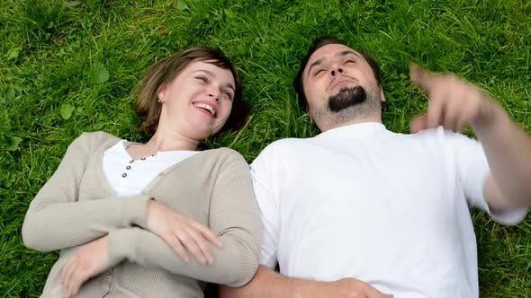 Thumbnail for Middle Aged Couple in Love Lying in Grass and Talk