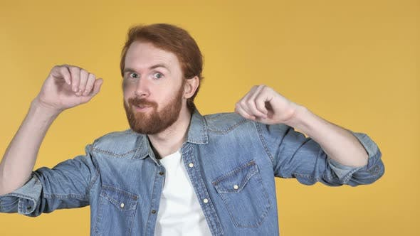Cover Image for Happy Redhead Man Dancing, Yellow Background