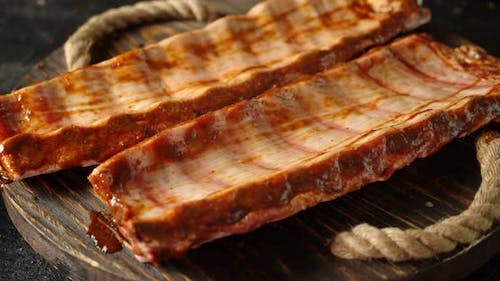 Raw Ribs on the Wooden Tray Slowly Rotate.