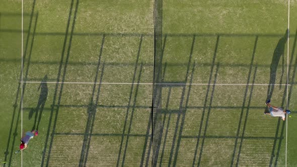 View From the Height of the Tennis Court Where People Warm Up Before the Game