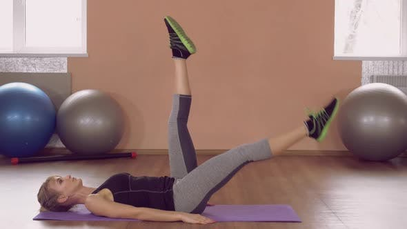 Thumbnail for Girl Doing Physical Exercises for Lower Abs