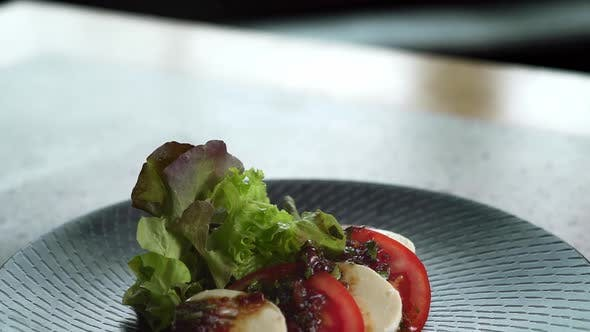 Thumbnail for Close Up Motion of Caprese on Plate.