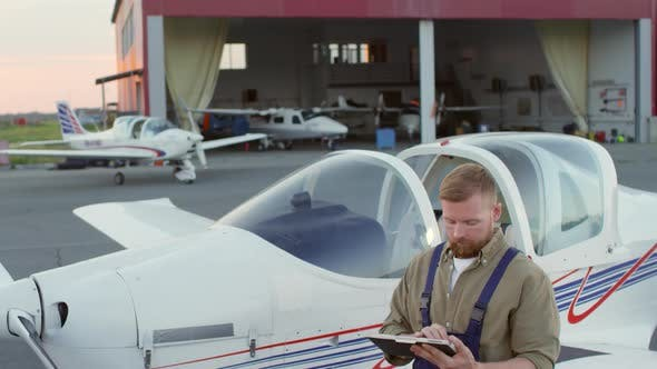 Thumbnail for Aircraft Mechanic Working with Tablet Computer