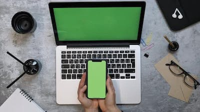 Phone and laptop computer with green screen