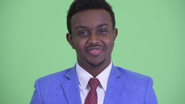 Cover Image for Face of Happy Young African Businessman Nodding Head Yes