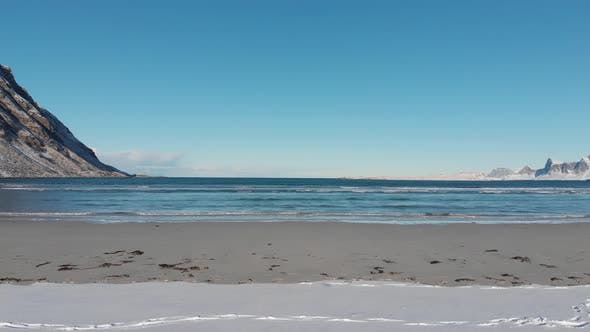 Thumbnail for Snow on the beach and on the sand with arctic ocean horizon