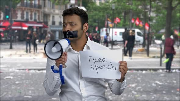 Portrait of Male Protester with Taped Mouth