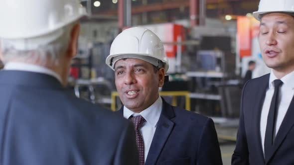 Thumbnail for Group of Business People in Hardhats Discussing Something