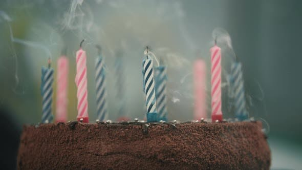Blowing Candles on Birthday Cake in Slow Motion
