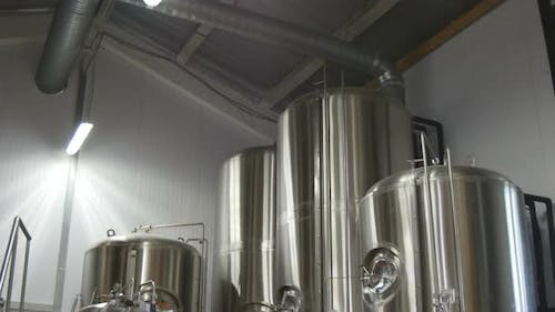 Beer Production In The Factory. Beer Is Cooled In Tanks.