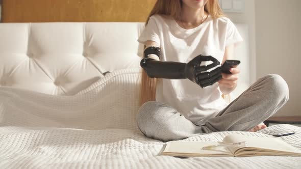 Thumbnail for Girl with a Prosthetic Arm Holding Remote Control.