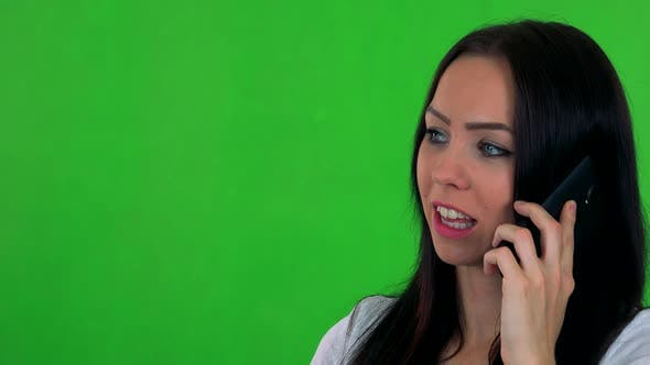 Thumbnail for Young Pretty Woman Phones with Smartphone - Green Screen - Studio