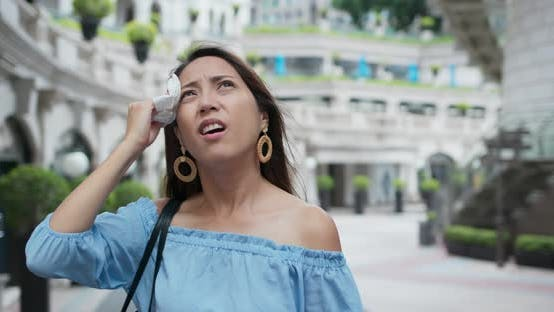 Woman feel so hot weather at outdoor in city