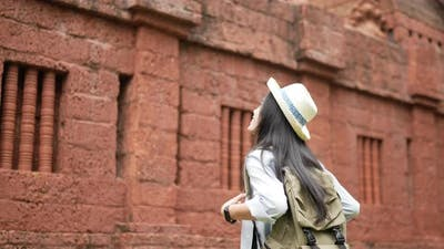 Woman visiting ancient temple