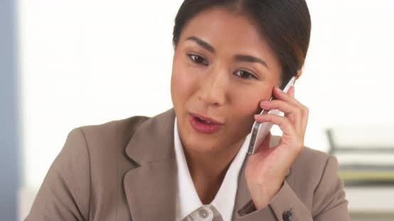 Thumbnail for Japanese businesswoman talking on smartphone