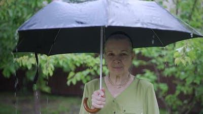 Old Woman Under Umbrella
