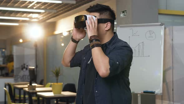 Thumbnail for Japanese Business Man Wearing Virtual Reality VR Glasses for Work in Modern Bright Office