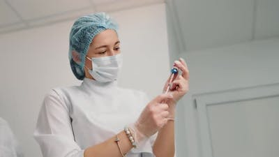 Nurse Typing the Drug Into a Syringe